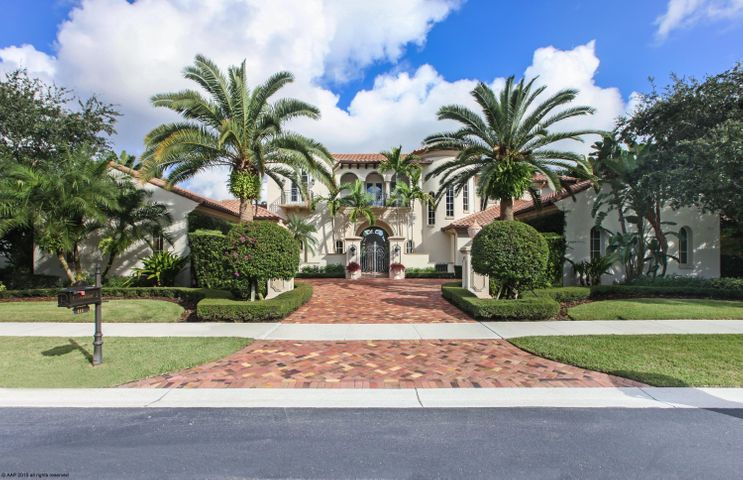 Within the gates of Mirasol Golf & Country Club, Live like a five-star resort in this architecturally timeless design; it envelopes every aspect of this custom Courchene-built estate. Date palm trees frame the entrance to the motor-court with accommodation for 4 cars within the garages. The front door opens to a large entry with barrel-vaulted wood beam ceilings and rich limestone flooring. There are 5 bedrooms within the estate, with both the Master, a guest suite, a walk-in wine room & separate theater room on the ground floor. There is an additional living area and three guest suites upstairs, with three balconies. The private tropical gardens outside & heated infinity pool, is perfect for entertaining complemented with an outdoor summer kitchen for dining. 2 fireplaces indoor & outdoor Master Bedroom is ultra-spacious, His & Hers Baths, 2-walk-in closets (her walk-in closet arguably the size of a bedroom) Her bath is appointed w/domed ceiling, dual granite-topped vanities & linen closets, freestanding soaker tub, marble floors, picture windows w/stunning water-feature overlooking privacy garden. Hurricane-impact French doors and windows, marble floors.  Come to experience what living within this estate home would offer your lifestyle.