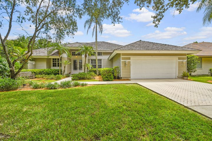 Located in the private gated community of The Preserve within the Shores - this single level home features 3 bedrooms, 2 1/2 bathrooms, 2 car garage, built in custom bar and library.  Nestled on a premium lot in the quietest part of the neighborhood, this home is perfect for entertaining or enjoying family time with a resort style patio, large lap pool, and a built-in summer kitchen. Enjoy beautiful sunsets over the lake on your oversized private side yard.  Roof replaced in 2006 and newer appliances. Impact front door and sliders in the family room, complete hurricane shutters for all other windows and doors.  Low HOA fees, and A-rated schools, just minutes to restaurants, shopping, and the beautiful Jupiter beaches.