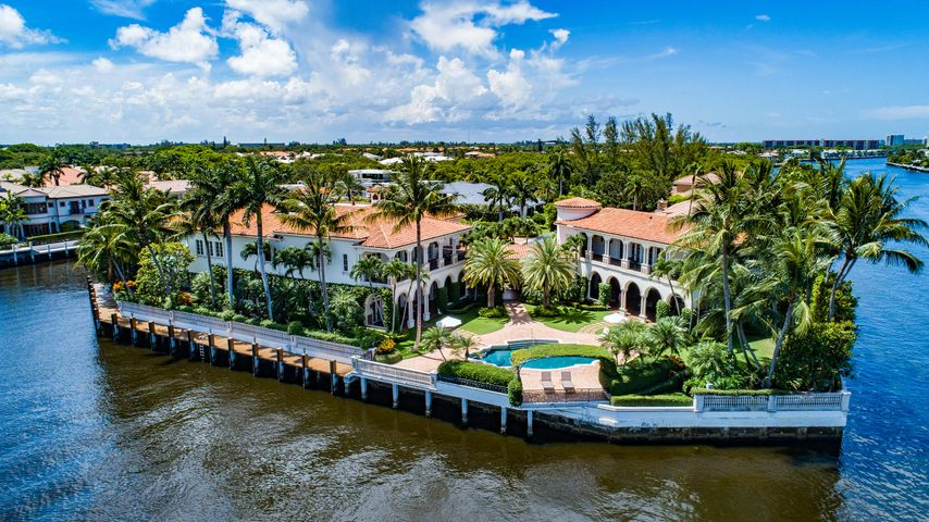 """Stately Palm Beach-inspired Mansion sited on The Sanctuary's finest 3.25 trophy Intracoastal point lots with 560+/- feet of amazing wraparound waterfrontage on 3 sides with protected mega-yacht dockage. Grand main house and separate guest house with connecting palatial loggia looking down the Intracoastal Waterway. Verdant formal gardens with meandering paths lead to a private children's/pet playground with specimen planting in complete privacy. Once in a lifetime opportunity to acquire this generational Boca Raton trophy estate.. Strictly shown by Appointment only to fully vetted and pre-qualified buyers with letter of Capability from a US Bank. DISCLAIMER: The written and verbal information provided including but not limited to prices, measurements, square footages, lot sizes, calculations and statistics have been obtained and conveyed from third parties such as the applicable Multiple Listing Service, public records as well as other sources. All information including that produced by the Sellers or Listing Company are subject to errors, omissions or changes without notice and should be independently verified by any prospect for the purchase of a Property. The Sellers and Listing Company expressly disclaim any warranty or representation regarding all information. Prospective purchasers' use of this or any written and verbal information is acknowledgement of this disclaimer and that Prospects shall perform their own due diligence. Prospective purchasers shall not rely on any written or verbal information provided when entering a contract for sale and purchase. Some affiliations may not be applicable to certain geographic areas. If your property is currently listed with another agent, please do not consider this a solicitation for the listing. In the event a Buyer defaults, no commission will be paid to either Broker on the Deposits retained by the Seller. """"No Commissions Paid until Title Passes."""" Copyright 2020 Listing Company. All Rights Reserved."""