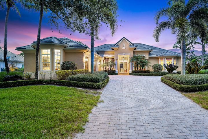 Welcome to Old Trail... a serene + picturesque gated enclave of 74 homes in one of Jupiter's most coveted + private locations. Winding roads and mature trees lead to this impressive home beautifully sited on a cul de sac between 2 private golf courses. No Membership Required.  Home is custom built by legendary golf builder, Arthur Rutenberg.  A grand brick driveway opens to a spacious motor court + 3 car garage.  Double door entry leads to main living areas which are generous in size w/ higher ceilings + views from every room!  Upgrades include 2 newer A/C's,  custom built ins in Office, water softener + 15 KW Generator. Premiere Impact W/D throughout (except for shuttered picture window).  Luxe Master Bedroom suite is separate + private. Chefs kitchen w/ GE Profile appliances + Island is designed for joyous gatherings. Adjacent large family room offers great space for relaxation.  It opens to screened lanai w/pool, spa + summer kitchen... Picture postcard views for as far as you can see! Old Trail residents enjoy the ease of near town living along with the serenity of country life surrounded by nature, birds and walking trails.  Homeowners also benefit by the Martin County tax zoning!  A truly exceptional place to enjoy the finest in Florida living...