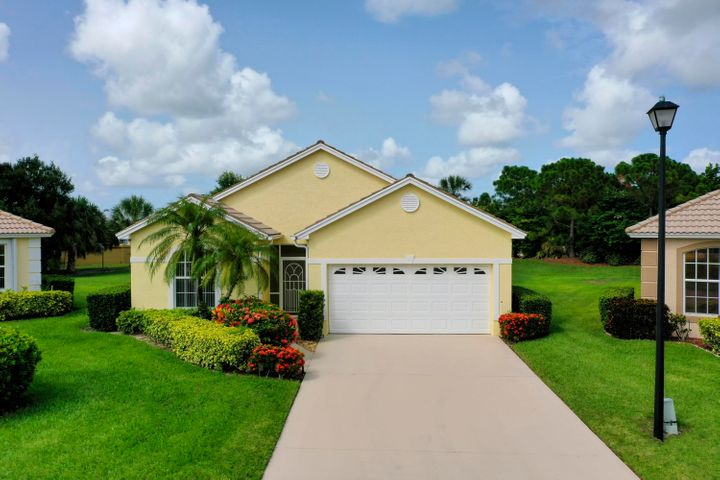 Enjoy luxury living and Florida sunsets within the comfort of your new home in Kings Isle. a gated 55+ community! This CBS Construction home is freshly painted, boasts 2 Bedrooms, a Den, and 2 full Baths right in the heart of the prestigious, master-planned community of St. Lucie West. Entertain in this spacious living room and open concept kitchen with newer appliances, breakfast bar & pantry, including the enclosed screened-in Lanai to create memorable evenings. There are plenty of walking and biking trails as well parks and natural spaces at Kings Isle. This home also includes a recently updated A/C, Washer and Dryer. Florida living with all of the amenities right here at Kings Isle.