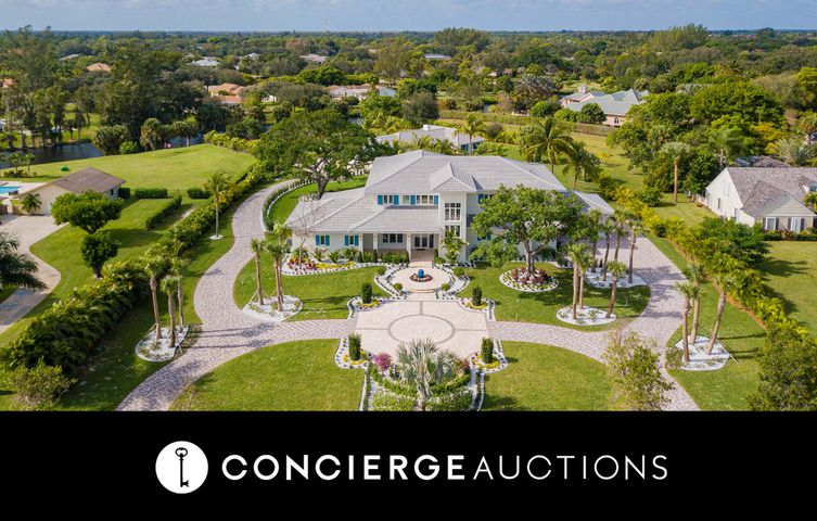 Previously $3.995M. No Reserve. Open Daily 1-4 by Appt. The first thing you'll notice about 8335 Kelso Drive is an expansive and welcoming wraparound front patio. This sprawling contemporary, canal-front estate offers almost 10,000sf and 2 acres of indoor and outdoor entertaining and living space. The open-plan layout is perfect for hosting. Its soaring ceilings, oversized windows, and rich wood floors create a luxurious, yet understated designer-ready canvas. A professionally-equipped kitchen is equally comfortable whether you are preparing casual family favorites or prepping for a lavish dinner party. Guests will feel at ease with separate quarters, conceived with the same luxurious finishes as the main house. Take full advantage of the South Florida sunshine and your resort-style living