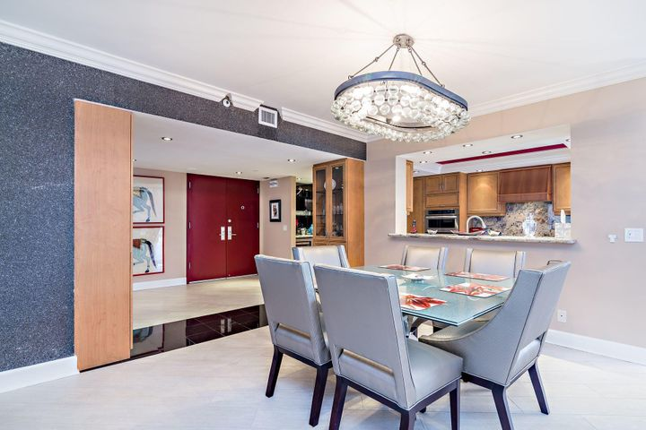 Stunning residence offered fully furnished (turnkey) excluding artwork.Porcelain tile, open kitchen, 3 1/2 designer baths,custom furnitureMartinique 2 offers a private restaurant, 2 tennis courts, fitness rooms, 24 hour concierge and manned gate, bocce court, library, billiard room. I