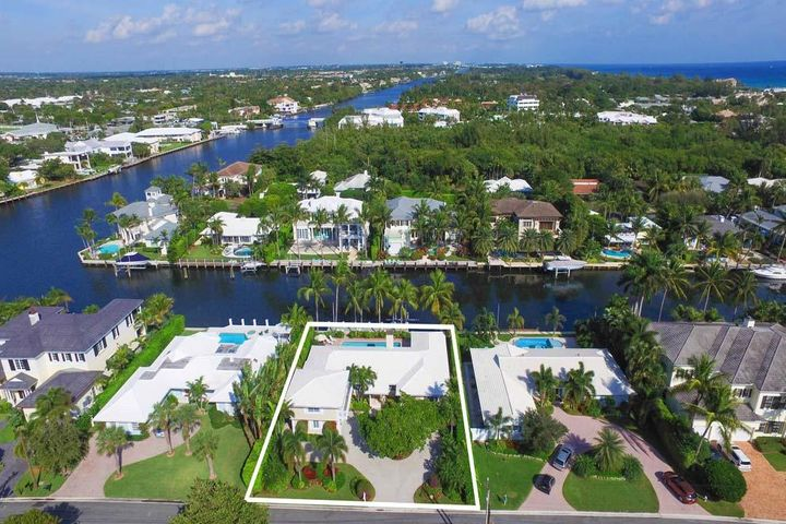 """Do not miss this rare opportunity to own an incredible East Delray Beach property situated in a location and on a street that are second-to-none. Boasting 100 feet of waterfrontage just three lots from the point allowing for Intracoastal views, the residence invites the buyer to move in and enjoy; renovate; or build from the ground up on this wide interior canal with constant flowing water. The home offers four bedrooms including separate upstairs guest suite, open living areas and two-car garage. Enjoy the spacious grounds with circular drive, private yard, pool and dock. Located just two blocks from the Atlantic Ocean and five blocks to Atlantic Avenue, this waterfront residence is a prime spot for enjoying the South Florida lifestyle. FEATURES: """"100 Feet of Waterfrontage """"Beach Area Property: 100' x 130' """"4 Bedrooms / 4.1 Baths """"3,594 A/C Square Footage """"4,338 Total Square Footage """"Move In, Renovate or Build """"Formal Living and Dining Rooms """"Family Room Overlooking Pool and Waterway """"Master Bedroom with Walk-in Closet, Master Bath and Private Sun Room """"Private Guest Suite on Second Floor """"Decorative Patio with Lots of Room for Outdoor Dining and Lounging """"Pool """"Private Dock with Nearby Inlets for Ocean Access """"Blocks to Beach and Atlantic Avenue  This waterfront residence located at 1101 Island Drive, Delray Beach is priced to sell and offers endless possibilities."""