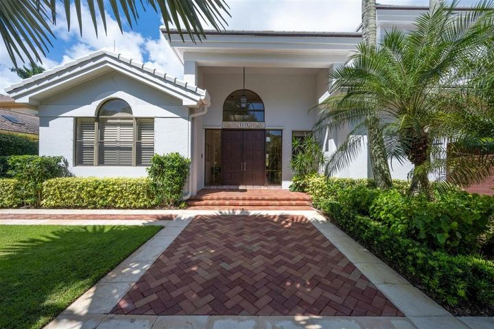 Exceptional golf course and lake views from this 4 bedroom 4.5 bath plus den home located on the 14th fairway on a premiere 1/3 acre lot in the prestigious Loxahatchee Club.  The brick paved driveway, and double wood front door entrance opens up into a spacious light and bright living area with vaulted ceilings & transom windows.  There is  a den/office and half bath/powder room upon entering the home. The expansive downstairs master bedroom suite has access to the lanai and pool area. The master bathroom has luxurious marble finishes of  the floors, shower and vanities. The first floor guest bedroom has a fully renovated marble accented bathroom ensuite.  Two additional bedrooms and full baths are located on the second floor of the home. The outdoor lanai is perfect for friends and family with a screened pool and spacious shaded seating area. The roof of the home has been replaced within the last five years. This residence has tremendous value at an attractive price point ! A must see!