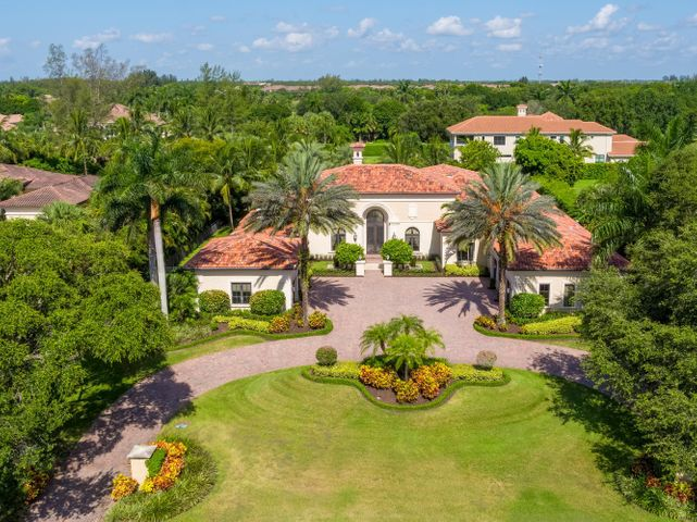 THIS IS IT!  A single story, Premier Estate Home with 6 Bedrooms plus office, 6 1/2 Baths, 5 -  extended car garages with 9,938 total sq. ft on acre+, fenced in lot. This gem is located in the prestigious community of Steeplechase with only 325 acre+ custom homes, no membership requirements, minimal HOA dues & manned guard gate in the heart of Palm Beach Gardens. With soaring ceilings and great room design, this home provides the overly generous CLOSET SPACE in the bedrooms, living areas and garages you dream of - but rarely see. The double-island gourmet kitchen has double ovens, 2 dishwashers, Sub-Zero refrigerator & freezer, GAS RANGE and walk-in pantry. A luxurious Master Bedroom Wing with sitting area boasts separate bathrooms & closets, jacuzzi tub and a wide/deep shower offering.. dual showers & body jets. Both the Master bedroom and family room with disappearing sliders open to the pool, spa and expansive lanai with summer kitchen. A spacious lawn offers the perfect place for kids to play or dogs to run. This home has hurricane windows,a whole house generator & water filtration system, SMART home automation, indoor/outdoor Lutron LED lighting and sound system. LOOK at Matterport video. Must be seen to appreciate the exceptional quality and additional features.