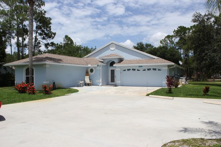 Desirable Jupiter Farms, 4 bedroom 2.5 bath CBS pool home. NEW Impact Windows and Doors! NO HOA FEES!  Located on a paved road. Open floor plan and impeccably maintained. This 2095 sq. ft.(under a/c) home sits on 1.09 acres and is fully fenced with mature trees. New master shower, newly renovated 1/2 bath, new concrete circular drive, expanded and re-screened lanai, new a/c, new central vac, newly re-bedded water filtration and new pool pump and heater.  The extra 300 square foot building can be the perfect man cave, she shed or extra car garage! Close to Jupiter Farms Elementary school, parks, shopping and quick access to I95 and turnpike!  All sizes approximate.