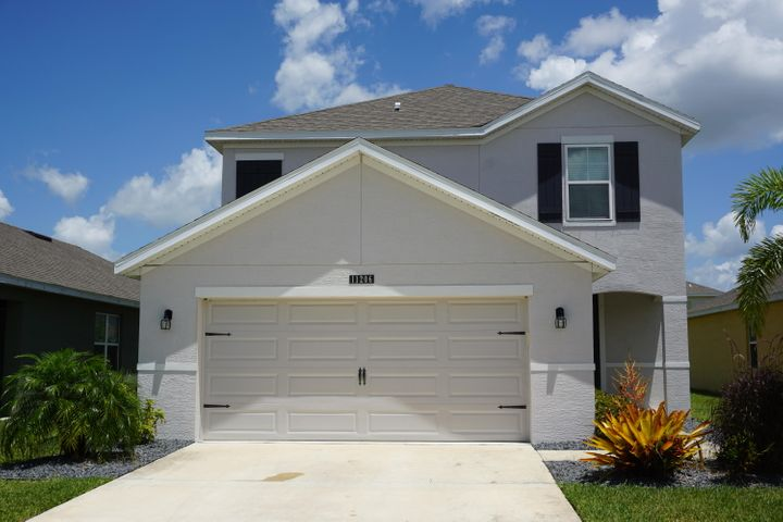Immaculate Newly Built 3 Bed 2.5 Bath 2 Car Garage CBS home. Located in Victoria Parc Manors Subdivision in desirable Tradition of St. Lucie County! Lots of room for Entertaining with plenty Counter space, Stainless Steel Appliances and Open Concept. Bedrooms and Laundry located on the 2nd Floor with Dual sinks in both upstairs bathrooms. Close to I-95, Dining, Shopping and much more!!Come see for yourself all this home has to offer.