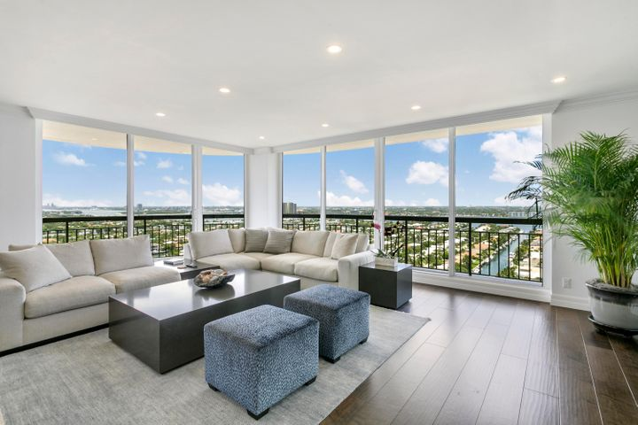 Visit today, stay forever!  Experience the beauty of island living in this elegant and serene condominium, completely renovated from top to bottom.  Perfectly designed with white framed, floor to ceiling, impact windows and soft, remote-controlled solar shades throughout.  Over 2011 sq. ft. of interior space including 2 large bedrooms and 3.5 bathrooms.  A modern-leaning design with an open kitchen including Subzero and Wolf appliances, marble countertops, His and Her's master baths and a stunning walk-in closet.  A southwest corner provides ocean views and completely unobstructed views over the Intracoastal Waterway, with balcony sunlight in the winter, shade in the summer and sparkling city lights every night of the year. Relaxed yet sophisticated furnishings are perfect for perfect for entertaining.  All you need to do is sit back, relax and enjoy the tranquil sunsets.
