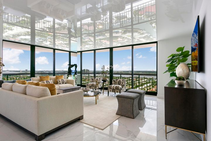 Create your own personal getaway, inspired by ocean breezes and magnificent sunsets.  Modern design elements-offering the best comfort, completely furnished, spacious open floor plan... a kitchen area any Chef would admire. Top of the line appliances, ample storage, massive island area for entertaining. Floor to ceiling impact windows with views reflected in the ''stretch'' ceiling that visually create a higher ceiling. The master bedroom is elegant and cozy with his & her's bathrooms with large walk-in closet. Electric shades in bedrooms.  Perfection without compromise! Over 2,000 SF of interior space. Come and enjoy coastal living!