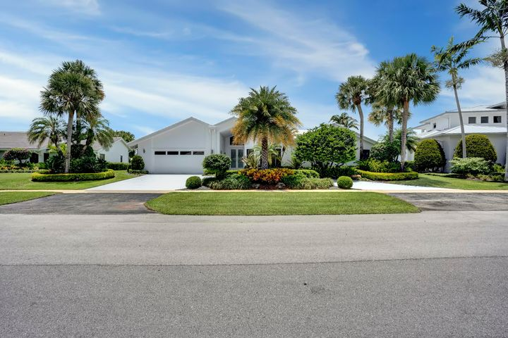 Awesome, sought after lake and golf views, southern exposure in highly desirable, centrally located Delaire Country Club. You are welcomed by a circular driveway then greeted by a bright airy home with a grand living room hallmarked by a cathedral ceiling, complete with entertainment bar while open to a large eat-in white kitchen with an abundance of cabinets, also a bumped out, large den area for separate seating, media entertainment area or office. Ceilings are also accented with tailored coffered cuts to add dimension and style. Four graciously proportioned bedrooms with fabulous views including a sizable master with custom built cabinets, built out walk-in closets and dual basins. Additionally, there is a laundry room with built-in cabinets. Gorgeous resort like setting pool with travertine decking, hot tub, tropical landscaping and panoramic views of the pristine golf course. Delaire is a private boutique country club where 324 custom homes surround a BRAND NEW 27 hole, championship, no tee time golf course. The newly built clubhouse houses a state of the art 16,000 sq ft fitness center, outstanding culinary cuisine, a resort style pool area, 8 har tru tennis courts and more! Generous extended family policy as well!
