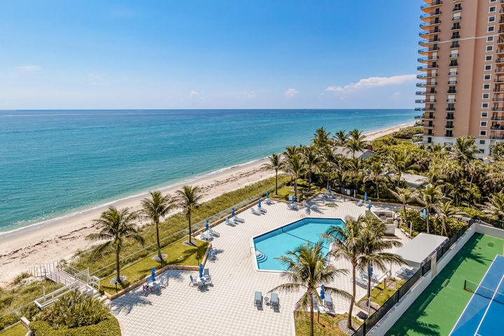 SE oceanfront view.  Split floor plan. Open kitchen with Stainless Steel appliances, granite counter tops, washer/dryer in kitchen. Crown molding, hardwood floors, Master bedroom has custom closet guest bathroom, granite counter top, walk in shower. Large guest bedroom with walk in closet, walk in shower. granite counter tops. Large balcony overlooking the ocean and pool. Impact hurricane windows & doors, shutters, wood floors, underground assigned garage parking. 24 hour doorman, security gate to the beach. Security cameras on property. Large pool tennis court. New renovated lobby, workout room and community room. Enjoy Singer Island Life style.