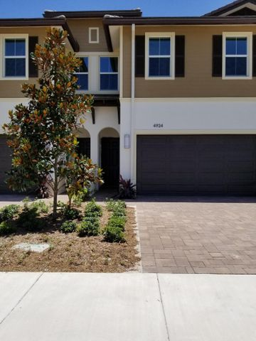 Here is your opportunity to live in a relatively NEW TOWNHOME IN POINTE MIDTOWN.  This 3 bedroom 2.5 bath and 2 car garage offers you everything you could dream of.  Everything is state of the art that includes IMPACT WINDOWS AND DOORS.  No worries here for bad storms or hurricanes.  You have your own private patio off the living room for your added pleasure to sit relax have a coffee or a glass of wine.  You also have the ability to have a nice grill for those steaks you love to cook.  The community offers a lovely heated pool and covered veranda for your enjoyment.  You cannot beat the location walk to all your favorite restaurants and shops.  This community is between 95 and the Florida Turnpike which adds to your convenience.  AVAILABLE NOW.  NO CATS 1 DOG ONLY WITH OWNERS APPROVAL.