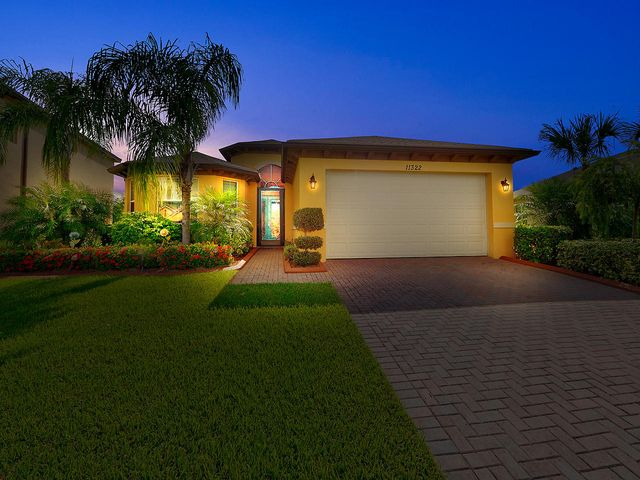Enjoy the Florida lifestyle with this beautiful 2 bed/2 bath/den home with highly desirable features! Step into foyer to be greeted with custom wood work on the ceilings, ceramic tile flooring, and a large formal dining area. The kitchen features a snack bar, dark granite counter tops, white wood cabinets, and stainless appliances. The spacious family room with custom fireplace contributes to the overall openness of the floor plan and has plenty of room for activities or relaxation. The master suite features wood flooring, a custom wood worked tray. ceiling, and a walk-in closet with custom built-in cabinetry. The master ensuite bath features dual sinks and a separate shower. The covered and screened patio area features lush garden views and is the perfect place to unwind after a long day.