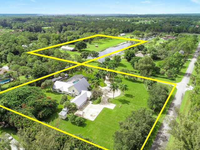 """Equestrian estate on a sprawling 7.5 acres. Enjoy your private country haven while only being 10 miles from the beautiful beaches, dining, shopping, and all the activity Jupiter has to offer.This 4,539 sq ft 4 Bedroom 4.5 Bath home sits on 2.5 acres of perfectly maintained and lush landscaping with naturally self sustaining pond irrigation. Well-appointed, newly remodeled kitchen featuring quartz countertops, herringbone ceramic floors, double ovens, pot filler, and a massive center island. Two master suites: one on ground floor and the other on the upper level. This home is the entertainers dream with the fully screened patio for the pool, outdoor summer kitchen, sauna, bocce ball court, and horseshoe! Barn is situated on 5 fully fenced acres presenting 6 """"in and out"""" stalls with dutch doors. Extra wide isles for ease of use for your day to day. Fully equipped with round pen, electric/water, bathroom, tack, storage, and feed room. Roll down hurricane doors for storm protection.  10959/10532 Pinewood Trail is conveniently located at the front of Jupiter Farms making for quick access to I-95/Turnpike and only 30 miles to Wellington for world class equestrian venues. This community offers enhancing amenities such as: The Jupiter Farms Park Equestrian Center offering both sand and grass arenas, and Riverbend Park, a large, highly-rated facility with endless hiking and biking trails, great kayaking, and the best of Florida's outdoor life. Barn can be purchased separately for $550,000."""