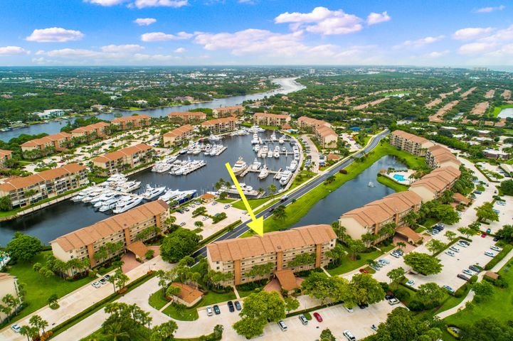 Beautiful waterfront Condo with incredible Marina views from your 5th story 140 sqft balcony! Recently updated, with private library and vaulted ceilings.  Enjoy the 4 swimming pools on site and additional tennis and bocce ball courts.  Pets under 20lbs are welcome. Full service Marina with ocean access on site!  This magnificent condo is within walking or biking distance to Jupiter Beaches.  Shopping and restaurants are minutes away from your doorstep.  Less than 30 minutes to Palm Beach International airport.