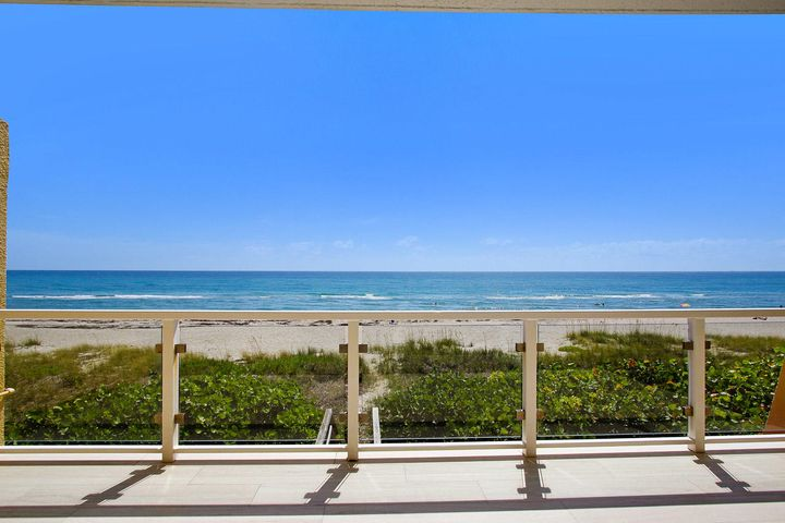 VERY RARE... DIRECT BEACHFRONT TOWNHOME~ LOCATED in DESIRABLE JUNO BEACH; Unobstructed ocean views from every room, this property has been renovated first class with a coastal interior design including new impact window and doors, white washed pecky cypress ceilings in dining and family room, custom lighting, porcelain floors, granite in both Kitchen and wet-bar with lighted glass. Master bathroom features large shower with ocean views, double sinks, large walk-in closet with custom built-ins and small office/exercise room. Guest bedroom lives like a separate suite with a family room, sunroom, custom built-in's and an adjacent wet bar. Directly outside your door is the dune walkover to beautiful Juno Beach with an outdoor shower. Juno Beach is conveniently located... See Supplement... just minutes from fantastic restaurants & shopping in Palm Beach County with easy access to Palm Beach International Airport!  Call today for your private showing!  Virtual Showings available!