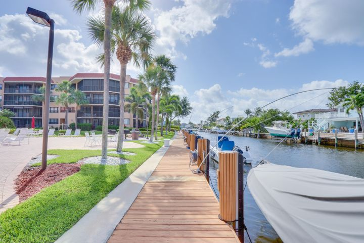 It is rare to find such a lovely condo overlooking the water in East Boca Raton for such an amazing price. This 2 bed and 2 bath home has a nicely updated kitchen with granite countertops, appliances that are only 1 year old and an amazing patio overlooking the pool and canal with easy access to the intracoastal. Closets, closets and more closets. The closet space is amazing!! Close to hospitals, restaurants, highways, schools, shopping and much...much more. Make an appointment to see this today, or you will end up locked in your bedroom for weeks crying because you missed out. There may be dockage available from association...