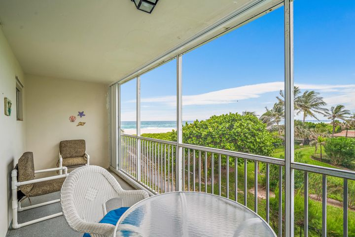 Directly on the sand, beachfront condo with ocean views from every room, Low HOA fees,assigned parking, heated pool, and beach access just a few steps away from apartment. Villas on the Ocean is a laid-back and carefree community located just minutes from the fantastic restaurants & shopping located in PB County with easy access to Palm Beach International Airport!