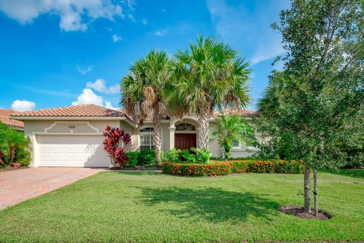 Estate Home in  55+ Vitalia at Tradition. Harvest Mist model w/ soaring ceilings & windows to bring Florida's casual living to life. 3/2.5/2, 2334 sq ft. Light & bright - formal living & dining rooms adjoin family room/kitchen, for an open feel w/ private spaces for all. Perfect for entertaining, family gatherings, this 3 bedroom 2.5 bath home has 2 split bedroom suites. The 3rd is off the family room; a bedroom, den, office, studio. , or... SS appliances,cherry wood cabinets, gas stove, & snack bar to visit with the chef. A casual dining area overlooking the lush landscape. Master suite has large his and hers closets, garden tub w/separate shower, & dual vanities There is a 1/2 bath off the back hall. 2 screened porches open to brick paver patio & a  lakefront patio. Impact windows, lush custom landscaping. 55+ community w/ beautiful clubhouse, pool, lakeside pavillion, tennis as SO many activities.