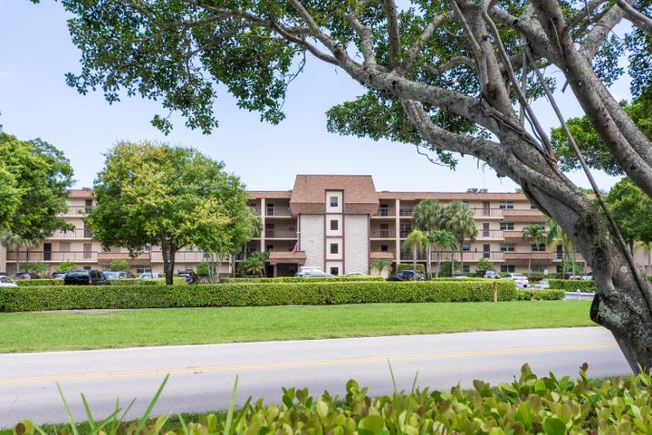 Meticulously updated unit with Privacy & Safety in Mind. Charming 3rd Floor Unit in ALL AGE BUILDING. 2/2 + Den! Master Bedroom has access to large Screened Patio with view of the Future Boca National Golf Course!! All windows equipped with Shutters. Tankless Hot Water Heater, A/C Thermostat connects to your Cell Phone. Kitchen updated and  Ceiling raised. Laundry Room in unit with Full Size Washer Dryer. Tile throughout. Built In Surround Sound Speakers. Move in Ready. A/C Bike Room & Storage Unit on 1st Floor.  Parking Space is as close as you can get to Entrance of the Building! Loads of Guest Parking! Convenient East Boca Location Close to Mizner Park, Beaches, shopping and also The Avenue in Delray Beach!   Furniture Negotiable