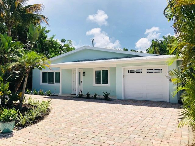 Walking distance to the ocean. PGT Impact windows and doors, Impact garage door, polished concrete floors throughout, A/C 2017, GE profile kitchen appliances, Samsung washer/dryer 2019, water heater 2020.NEW: interior and exterior paint, baseboard/trim and doors, gutters, recessed LED lighting throughout.