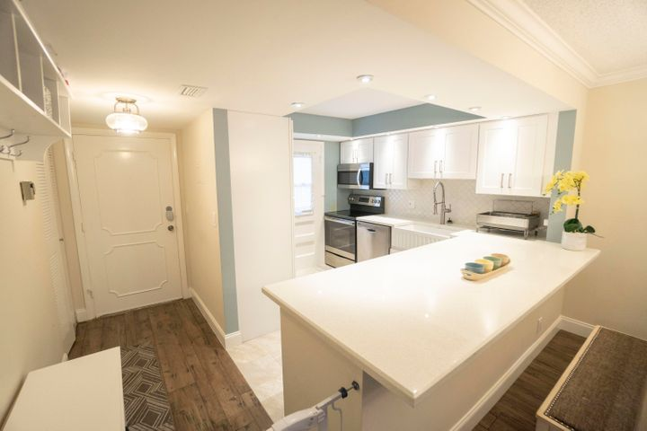 Beautifully renovated 2bd/2bath+den, 2miles from the beach, 3rd floor CORNER UNIT with private view overlooking the pool and soon to be state of the art $25million public Boca National Golf Course. Maintenance fee includes premium cable package, internet, water, pest control, and reserves. Brand new hurricane impact windows throughout the entire unit, including a rare enclosed glass patio. Washer and dryer inside. Plenty of closet space, with additional storage in the community laundry room. Excellent location with secured lobby entrance, A+ schools, very close proximity to Delray Atlantic Ave. and Mizner Park in Boca. FAU, Lynn University, and Palm Beach State, all nearby. Investors dream before golf course completion. Rentable, all age building.