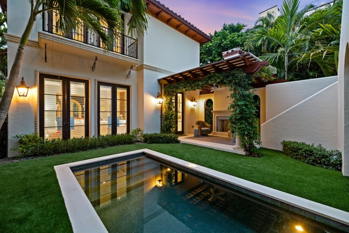 Private back garden with french doors to family room. Master balcony above.