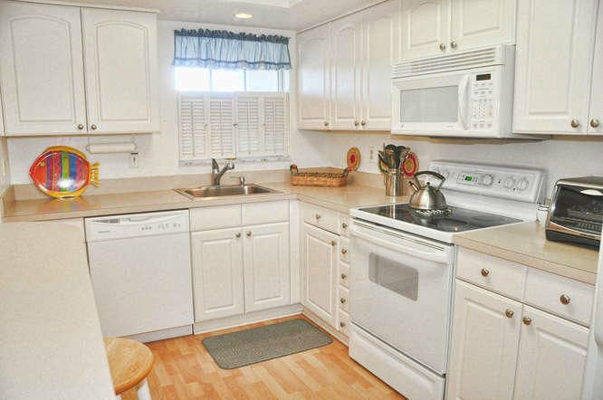 Enjoy this fully furnished, bright  and spacious condo on Singer Island Coastal style furniture for your new island lifestyle.  Kitchen has been remodeled , which opens up to the living area .   Bright spacious covered balcony to enjoy the ocean breeze .  Make this your winter retreat or year round living.  Active community offers , Olympic  size lap pool, tennis courts, shuffleboard, community BBQ area, card room, pool table area , library and community room with updated kitchen. Boats slips available for sale or rent .  Short stroll to the community pool, clubhouse and beach.. Great location for a great price.   Call today for a private virtual or in person showing.
