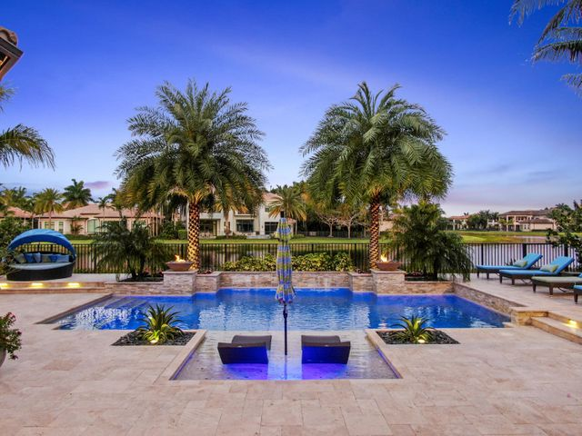 Over HALF A MILLION DOLLARS IN UPGRADES, not including the PREMIUM WATERFRONT LOT this one of a kind home sits on! This CUSTOM two-story Sebastian model home features 4 BEDROOMS, with the GRAND MASTER RETREAT on the first floor, 4 FULL and 2 HALF baths, CLUB ROOM and OFFICE. This elegant home boasts a MODERN POOL, GARAGES for THREE CARS and FULL HOUSE GENERATOR. From the moment you enter, every detail of this open floor plan home will TAKE YOUR BREATH AWAY, starting with the BACKLIT ONYX ENTRY WALL, 22' CUSTOM MARBLE AND ZEBRA WOOD GREAT ROOM WALL UNIT, DESIGNER CHANDELIERS AND DECOR to the top of the line luxurious upgrades. The oversized Master suite with gracious marble Spa Bath, oversized Rain Shower and Dual Vanities, is complete with professionally outfitted His & Hers Closets. The home's 24 x 24 high gloss marble floors are exquisite, along with the views through the FLOOR-TO-CEILING glass doors that allow you to capture the amazing outdoor living space complete with a CUSTOM DESIGNED HEATED SALTWATER 26' x 34' POOL, Multilevel lit marble decking, Fire Bowls, River Rock Sun Shelf, Fountain Wall, Lush Landscaping and incredible Lake Views. Lounge and relax with the Sonos system inside and out. Set the mood and ambiance of this automated home by controlling your pool, lighting, audio, ALL with an app system. Did we mention this home also has a CUSTOM SAUNA FOR 4,  Drop Down Phantom Screen, Security Camera, Invisible Indoor Speakers, Pool Water Features, Built-in Marble BBQ Grill, Epoxy finished garage floors and much more? You will love living in the BEST HOUSE in THE HOTTEST NEIGHBORHOOD in Delray Beach, THE BRIDGES with Clubhouse,Tennis, Restaurant, Playground and Community Pool.
