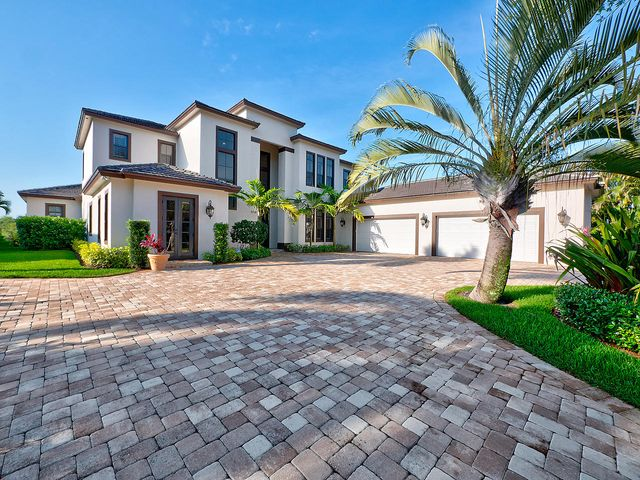 This Beautiful Riverfront home was newly built in 2017. This is Florida Living at its finest! With a grand entry and soaring 28 foot ceilings as well as water views at every turn. This open concept floor plan has a great room with built-in entertainment center and stunning views of the pool and the Loxahatchee River. The kitchen is a Chef's delight with two islands, quartz and stainless steel countertops, SS farm sink and all commercial grade Viking appliances, including the gas stove and SS hood. The master suite is on the main floor and it features a sitting area and his and her closets with built-ins. The master bath features dual sinks, vanity, garden tub, separate walk-in shower and a water closet. There are two offices on the main level, one of which has French doors. In addition to that there are two half baths, one which serves a cabana bath. There are three additional bedrooms upstairs all featuring walk-in closets and private baths. The laundry room has plenty of cabinetry for ample storage. The home has marble floors downstairs and wood floors upstairs. Additional interior features include crown moldings, plantation shutters and roll up blinds throughout.  The oversized four car garage is perfect for the car collector and can accommodate a full size F-250 in height. Exterior features include impact windows and doors, two covered patios and a 30x15 salt water pool with a sun shelf. There is also a 48kw Kohler whole house generator with a 1000 gallon propane tank. New seawall and new dock with two lifts, one for a larger center console and the second for a runabout. This stunning home is situated on a professionally landscaped .75 acre lot with ocean access. Bring your boat and your flip flops and start enjoying the Florida Lifestyle!