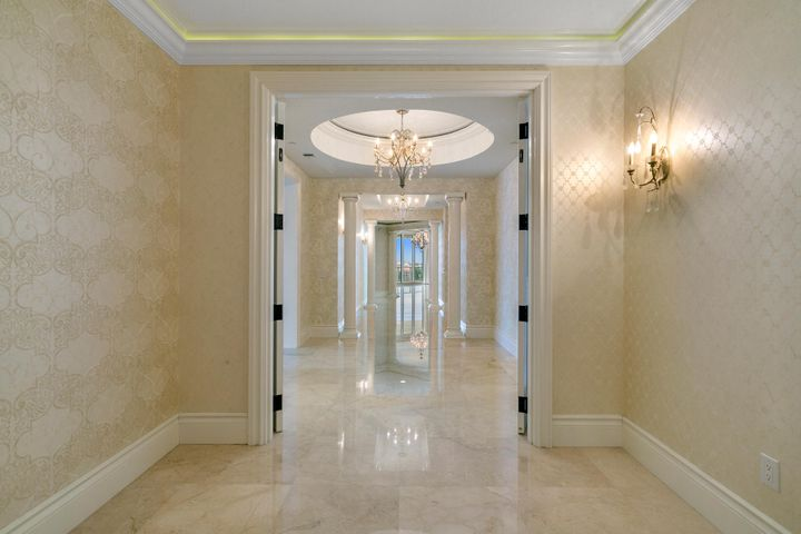 One of the largest condominiums in South Florida! Experience the ultimate lifestyle. The perfect blend of comfort, style and function. Over 7,440 SF of interior space. Multiple living areas with 9,179 total SF!!  A substantial home office overlooking the ocean - no commuting! The great room spans 33'' X 33'' and includes a kitchenette area with bar, wine cooler, refrigerator, ice maker and dishwasher. Perfect for family gatherings. The kitchen includes top of the line appliances,....click on see more  separate catering room. The dining room is suited for a crowd with additional eating area off the kitchen. The master suite is an oasis of relaxed spaces from the his and her bathing areas, separate walk in dressing rooms, a spacious ''getaway'' space for morning coffee or late-night chats The Ritz Carlton services are complemented with 24 hr. security, concierge, valet, private restaurant with pool service.  Conference room, library, media room and state of the art fitness center.  A private beach area awaits you with complementary seating....it's all here.  Come and enjoy the lifestyle.