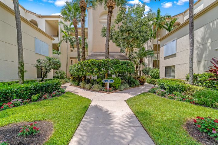 This beautiful 2 bedroom condo is located directly on the intracoastal. The kitchen has granite countertops, wood cabinetry, and the appliances have been updated. Enjoy your view of the water from the spacious living room, screened-in patio, and the master bedroom. The large master bedroom has high ceilings and plenty of natural lighting. Community features: lush landscaping with mature oak and banyans, protected marina w/ slips for lease or sale, 2 pools, hot tub, tennis, waterfront clubhouse with huge outdoor patio, fitness room, billiards and lots of space to entertain friends and family, manned 24/7 guard gate. Unit comes with 1 assigned carport space. Pet friendly up to 30lb. SELLER IS MOTIVATED