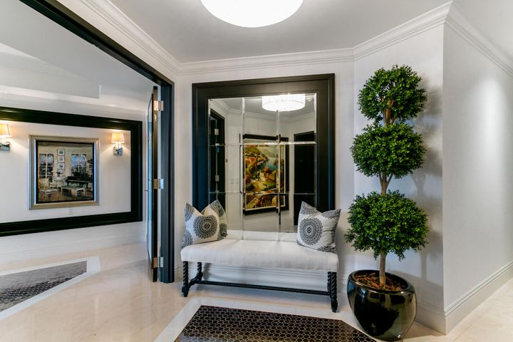 Location, Luxury, Resort Living.... Create your own personal getaway inspired by ocean breezes and magnificent sunsets.  With a cosmopolitan palate of crisp whites and black hues this condominium is the perfect setting for ''working from home'', an oasis away from city life. With over 3,600 SF of interior living area, this condo includes a spacious master suite, luxurious bathroom with Jacuzzi tub and a closet meant for all your best attire.  Two additional bedrooms with private bathrooms, and an office complete with storage, workspace and a sleeper sofa for extra company. A gourmet kitchen any chef would enjoy with top of the line appliance package and views of the ocean.  The living area is fit for a large gathering or quiet evenings watching events unfold along the ocean. See More...  City lights illuminate the night sky.  Managed by the Ritz Carlton Residences with renown services including valet, 24 hr. concierge, 24 hr. security, two pools, private restaurant, media center, social rooms and much more.  Come and enjoy coastal living.