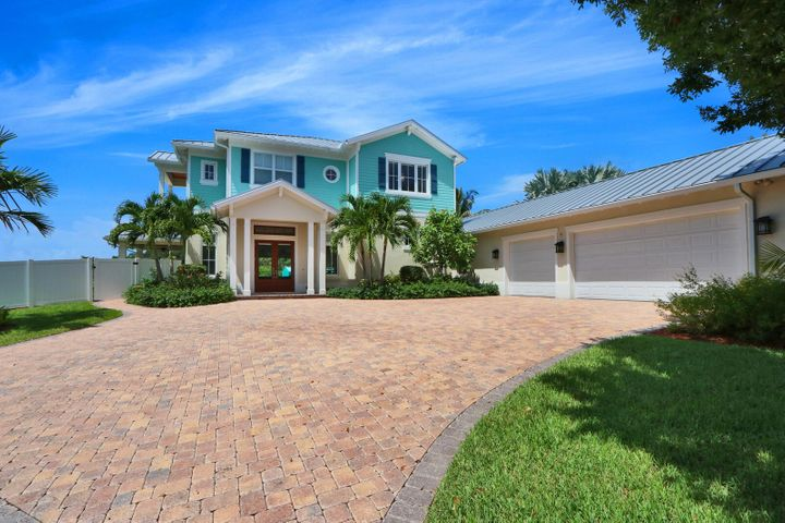 Just 5 minutes to the Jupiter Inlet! This incredible New Riverfront Home is located on the Loxahatchee  River with a 155ft of River Frontage on a Private Peninsula with Bahama Blue Water and within minutes of the Jupiter Inlet and Atlantic Ocean. A True Boater/Fisherman's Paradise! The home is built on 67 pilings with an additional 16 ready for your new pool. Brand new Seawall in 2019 and a covered Boat Dock for your watercraft Toys. Enter thru the double extra-large front doors and the first thing you see is a wall of glass overlooking the River; take in the huge open living space with volume ceilings, Gas Fireplace, Bose Sound System, Crown Molding, Automatic Blinds, Plantation Shutters and Real Stone Floor, Gourmet Kitchen with Thermadore Appl. A once in a life time opportunit