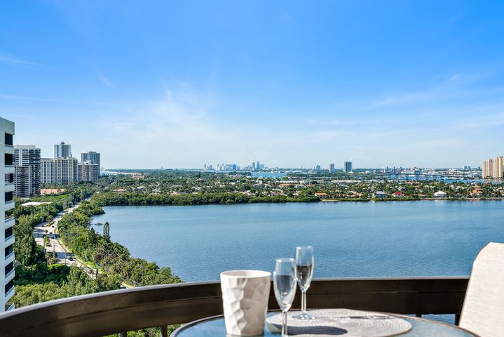 Amazing Southern Ocean, Beach and Intracoastal Waterway views from this sought after high floor 'A' stack condo in Eastpointe I. This completely renovated light filled residence has two large sunrise and sunset terraces with fantastic views of the lit up sky line at night from WPB to Jupiter. The flooring is large rectangular light colored porcelain tiles laid on the diagonal throughout and the renovations are all contemporary. The kitchen offers square edged white quartzite counters with custom thermophile white gloss cabinets and intricate backsplash. The counter is extended as a buffet to the window in the eat in kitchen area. Both bathrooms were redone with quartzite counter tops and white gloss cabinetry. Includes garage parking.