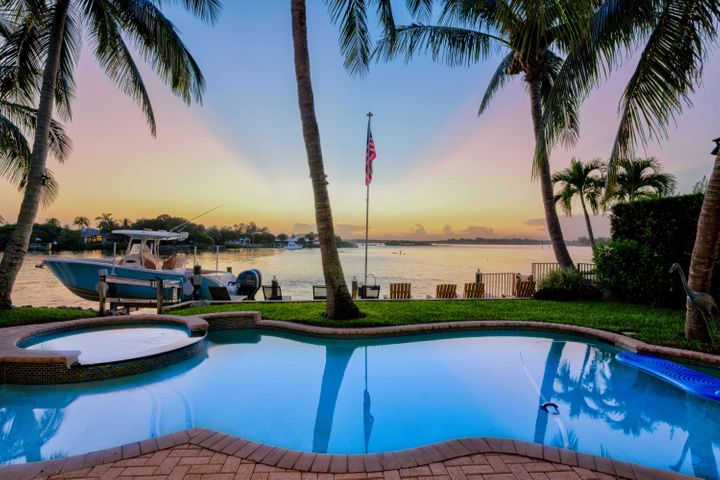 Stunning, wide blue water views from this Key West Riverfront home. Nestled into this private gated enclave of only 8 homes. Watch the maginficant sunsets over the River from almost every room in the house! Enter through the double front doors and the ceiling soars to 36' with an open floor plan. Office on the first floor can be converted into a first floor bedroom. An oversized 2nd floor covered balcony has access from the 2nd floor landing or the master suite. Minutes to the inlet from your private 16K # lift and plenty of depth at low tide. Gourmet Kitchen has gas appliances, center island and walk in pantry.
