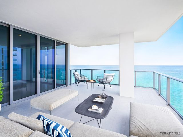 """Your private beach home awaits in this 3-bed, 4.5 bath + Family room residence with 3,753 interior sq. ft.  As one of only 48 residences at the newly completed boutique 5000 North Ocean, a private elevator welcomes you into a modern, ocean to Intracoastal residence. You will love the expansive, northeast terrace offering direct views of the ocean and 340' of Singer Island beachfront. West-facing terraces provide dramatic Intracoastal views. Includes two assigned garaged parking spaces & climate-controlled storage locker.  5000 North ocean provides a gracious lobby with full time reception & concierge services, club room, state-of the art fitness center, south facing oceanfront pool with sun all day, a secluded beach & cabana w/ fireplaces for entertaining.  Pet friendly. Others Available. Beautifully finished and delivered furniture-ready with designer coordinated selections. Expansive walls of glass, innovative architectural designs and crisp modern interiors combine to create an unprecedented coastal lifestyle.   Elegant, large format porcelain flooring (24X48) throughout with 8' solid core interior doors.   The designer kitchen features European cabinetry with the latest storage systems and integrated LED lighting. A large Cristallo Quartzite island with waterfall edges, Quartz countertops and full-height backsplashes.  Wolf and Subzero appliances include a 30' refrigerator and 18"""" freezer column, gourmet 5-burner GAS-cooktop with 36"""" retractable stainless steel canopy hood, under-counter microwave drawer, double wall ovens with warming drawer.  The bar area provides both a wine cooler & beverage center.  Owner's suite includes expansive closet space.  The bath finishes incorporate Lux High Gloss White European cabinetry, Nestos Brown marble countertop, with Grohe fixtures, Kohler sinks, and Toto toilets.  Guest baths appointed with same level finishes.  The laundry room has upper & lower European cabinets with large capacity Electrolux front load washer & dryer."""