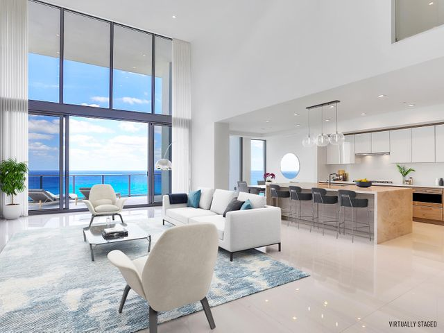 """Welcome to next-level luxury in this rare 2-story, direct oceanfront residence with 4 beds, 4.5 baths, 4,897 interior sq. ft. and family room.  As one of only 48 residences at the newly completed boutique 5000 North Ocean, a private elevator entrance reveals ocean views through a soaring 20' high glass wall.  You will love the expansive terrace overlooking direct views of the ocean and 340' of Singer Island beachfront. Includes three assigned garaged parking spaces & climate controlled storage locker.  5000 North Ocean provides a gracious lobby with full time reception & concierge services, club room, state-of the art fitness center, south facing oceanfront pool with sun all day, a secluded beach & cabana with fireplaces for entertaining.  Pet friendly. Others Available. Beautifully finished and delivered furniture-ready with designer coordinated selections. Expansive walls of glass, innovative architectural designs and crisp modern interiors combine to create an unprecedented coastal lifestyle.   Elegant, large format porcelain flooring (24X48) throughout with 8' solid core interior doors.   The designer kitchen features European cabinetry with the latest storage systems and integrated LED lighting. A large Cristallo Quartzite island with waterfall edges, Pure White Quartz countertops and full-height backsplashes.  Wolf and Subzero appliances include a 30' refrigerator and 18"""" freezer column, gourmet 5-burner GAS-cooktop with 36"""" retractable stainless-steel canopy hood, under-counter microwave drawer, double wall ovens with warming drawer.  The bar area provides both a wine cooler & beverage center.  The second floor also has a bar area with sink, dishwasher, and beverage center.   Owner's suite includes expansive closet space.  The bath finishes incorporate Lux High Gloss White European cabinetry, Mystery White marble countertop, with Grohe fixtures, Kohler sinks, and Toto toilets.  Guest baths appointed with same level finishes.  There are two laundry rooms both """