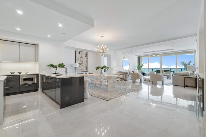 Brand new premier oceanfront residence at 5000 North Ocean on Singer Island. BEST PRICE in the building. This residence features unobstructed direct ocean views with floor to ceiling glass from every room of the great room floorpan. 2 bedrooms plus den and 3 baths, 2706 SF living space, and 505 SF outdoor terrace (3211 SF total living space). Prime unobstructed ocean views from the living and dining rooms, both bedrooms and kitchen highlighted by floor to ceiling sliding glass doors and windows. Private access controlled elevators open into individual private entry foyer. Thermador appliance package. Many upgrades in this unit including extra lighting and coffered ceiling detail. State of the art, brand new, low density, luxury building w/ oceanfront fitness center & resort-style pool.