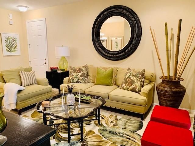 professionally decorated 2br/2ba+den on the lake! perfect vacation home at perfect location! community is gated has a pool and cabana.  I car garage!  WATER/SEWER, BASIC CABLE, ELECTRICITY UP TO 150/M ALL INCLUDED IN THE RENT!  Make your dream FL vacation come true!   AVAILABLE THIS 2021 SEASON!