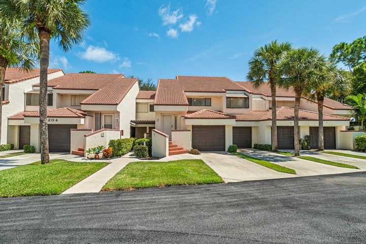 Upstairs unit with cathedral ceilings, eat-in-kitchen, split bedroom plan, enclosed patio, one car garage, large master bedroom, community pool, clubhouse and tennis all close to the beach.
