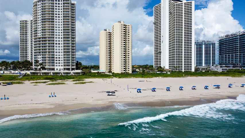 Amazing SE exposure looking down the beautiful wide Singer Island Beach This apartment is ready for a seasonal tenant or perfect to redo to make it your own. New A/Cs and a covered parking spot #151 mean it has everything needed to make it the perfect home on the beach