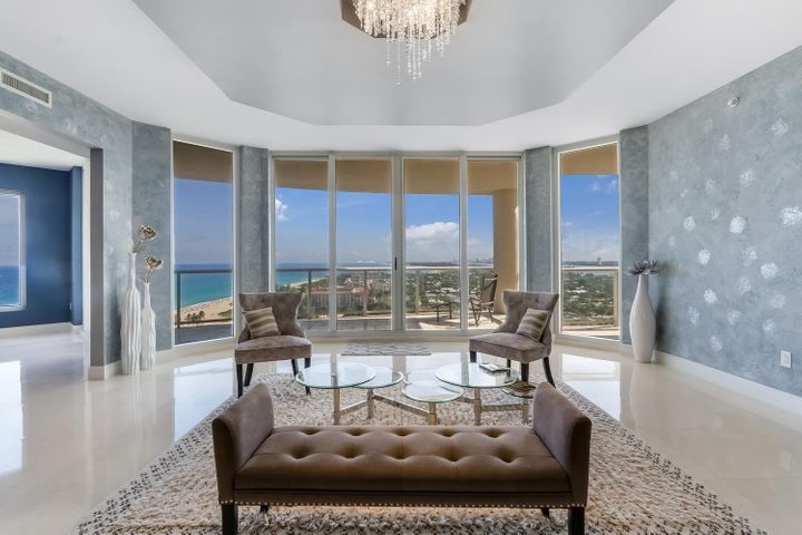 This fifteenth-level residence includes a private elevator entrance, 3 bedrooms, 3.5 baths, a den/office, dining room, and a gourmet kitchen with top-level appliances centered around an island. Each room has a direct view of water, in addition to its expansive balcony.