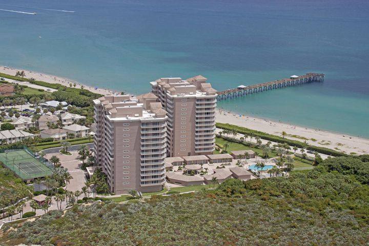 RARE FIND AT THIS PRICE FOR A 3 BEDROOM DIRECT OCEANFRONT CONDO  IN  THE FINEST LUXURY BUILDING JUNO BEACH HAS TO OFFER.  $50,000 CREDIT TO BUYER MOTIVATED SELLER.Very desirable open kitchen floor plan offers an ocean viiew.  Enjoy Stunning sunrises from expansive  balcony, master bedroom, and living room. Concierge building with gated entry & doorman. Private entry foyer with secure elevator to the floor. Underground garage. Master bedroom/ensuite bath, spacious walk in closet. Floor plan offers plenty of room for guests with bonus media rm/office.  Two guest bedrooms share a lovely second terrace to enjoy the sunset. Building amenities include heated pool and spa, coded gate entry to the ocean, tennis, pickle ball, fitness room, sauna, theatre, billiard room, card room/library, & social
