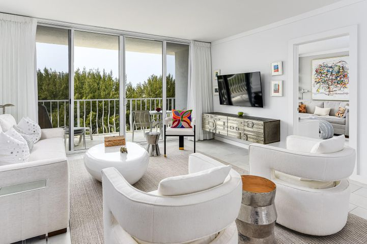 Furniture included and intact with the designer's vision. This gorgeous unit includes a highly coveted, covered parking space an in unit washer & dryer linens, kitchenware. Renovated throughout. Everything has been done with utmost attention to detail. Highlights include: hurricane impact glass doors, new water heater, all new kitchen appliances, ultra violet ''blue light'' in a/c unit to kill mold and germs, new, quieter a/c & heat pump, new porcelain tile floors throughout, marble in the bathrooms. The master bed is a king with a high grade Kluft mattress. Artwork, the needlepoint pillows and the antique wood cabinet in the master bedroom do not convey. Ask about remaining assessments. All information deemed to be true but should be verified prior to purchase as errors can occur.