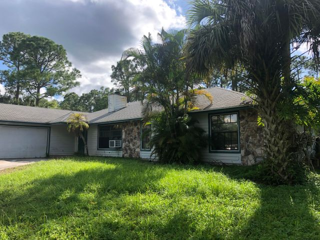Handyman or investor special. This is your opportunity to purchase a home in the desirable neighborhood of Jupiter Farms. This property is being offered as a short sale. Pool home on 1.25 acres will need upgrading.Please contact listing agent for appointment.