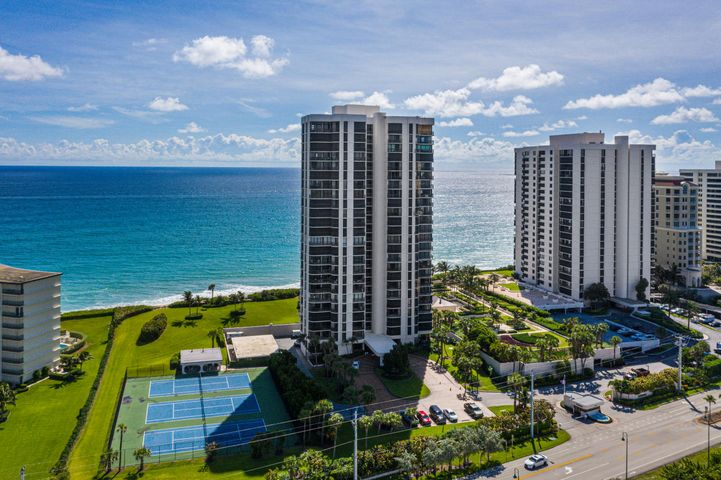 """PREMIER VIEWS ON SINGER ISLAND!!  360 DEGREES OF BREATHTAKING VIEWS - PRIVATE BEACH ACCESS -PERSONAL EV CHARGING - COMPLETE SMART HOME - FULLY UPGRADED WITH HIGH-END FINISHES! This sprawling 3 bedroom, 3 1/2 bath condo has some of the finest views that can be found on Singer Island! Upon entering the floor you are immediately struck by the space around you. Once inside, this modified floor plan has been opened up to provide 180 degrees of views from the main living area which include direct ocean, winding beachfront, Intracoastal, and beautiful city lights.  Balconies completely encompass this masterpiece with every room having balcony access from its 8 massive impact sliders! The owner has spared no expense with upgrades & special features which include but are not limited to: Smart home features such as; Smart Nest thermostat, GE Profile Kitchen Hub to control your smart home, Café"""" Professional Series 30"""" Smart Built-In Convection French-Door Double Wall Oven, Café"""" Smart Stainless Steel Interior Dishwasher with Sanitize and Ultra Wash & Dual Convection Ultra Dry, Monogram 24"""" Smart Integrated Column Freezer, Monogram 24"""" Integrated Column Refrigerator, smart washer & dryer, surround sound and more! High-end finishes include but are not limited to: 18x18 snow-white porcelain tile throughout, exotic 3cm quartzite marble countertops throughout, tap to open contemporary white flat door cabinets, updated lighting, frameless glass showers, multiple sprayers including rain showers in all baths, jacuzzi tub, premier parking spot with personal electric vehicle charging station and more! This building is located on an incredible spot of Singer Island where the views are superior! A paradise located close to fine dining, entertainment, and sandy beaches! This is one of a kind!"""