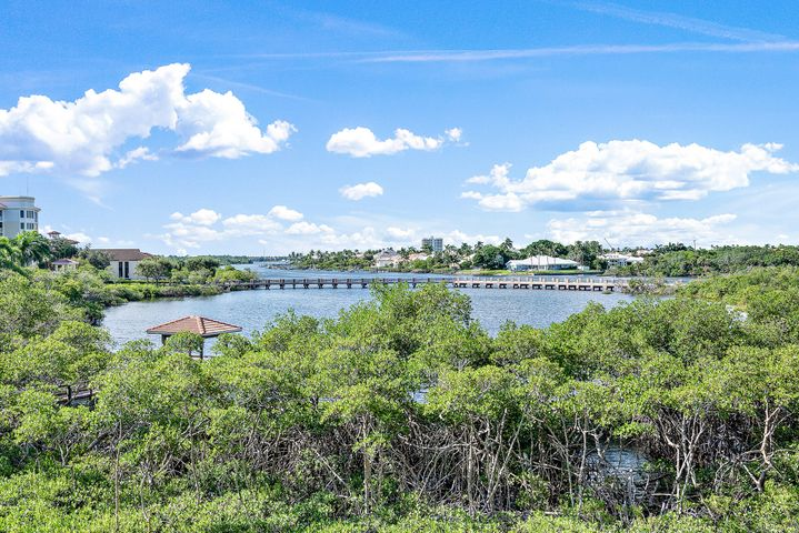 This is a rare opportunity to own a very desirable corner unit with three bedrooms and three bathrooms at the prestigious Jupiter Yacht Club. True corner units do not become available very often and offer a spacious, light-filled floorplan, with floor to ceiling sliding glass doors and serene Intracoastal views. Spanning just shy of 3,000 sf this condo feels and flows more like home, with a bonus family room adjacent to the kitchen. The 500sf wrap-around main patio provides separate areas to sit, dine, entertain and relax. This condo is being offered fully furnished. The Admiral Building at the Jupiter Yacht Club offers residents access to first class amenities including under building parking, a manned front gate, a saltwater pool & SPA, a summer kitchen / BBQ, a generator, as well as direct access to the Marina from the pool area. Two pets are allowed, one dog!  Boat slips in the protected Marina are available to lease or buy. The Jupiter Yacht Club is home to fine restaurants such as the Dive Bar and Cafe Des Artistes. Located in the heart of Jupiter, minutes away from the beautiful Jupiter beach and within walking distance to Harbourside and a selection of the area's finest restaurants, shopping, entertainment and golf courses!