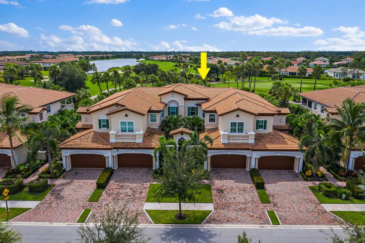 One of the best values in Jupiter Country Club, this ground floor Golf view carriage home is Move in Ready!  Newly built in 2015 this 2 Bedroom + Den home w/ great room floorplan (lives like a house) offers open chef's kitchen and a Spacious L shaped screen lanai... perfect for enjoying Florida's tropical sunsets.  Master bedroom is separate + private and boasts a Huge closet and luxe master bath.  Additional rooms include a spacious 2nd BR and an Office/Den.  Natural gas + Impact glass throughout.Residents on Tresana enjoy a low maintenance 'lock and leave' lifestyle, as all exterior + roof maintenance/replacement is covered by the association.   A golfers paradise, Jupiter Country Club offers a signature Greg Norman course + resort amenities as well as Amazing reciprocal privileges!